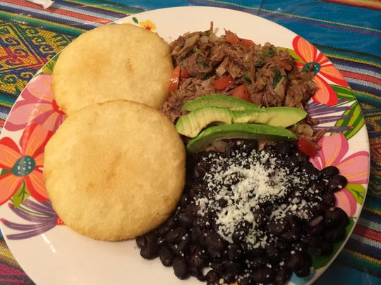 The Venezuela Plate at La Cocina de Chuy includes two arepas, black beans, shredded beef and avocado.