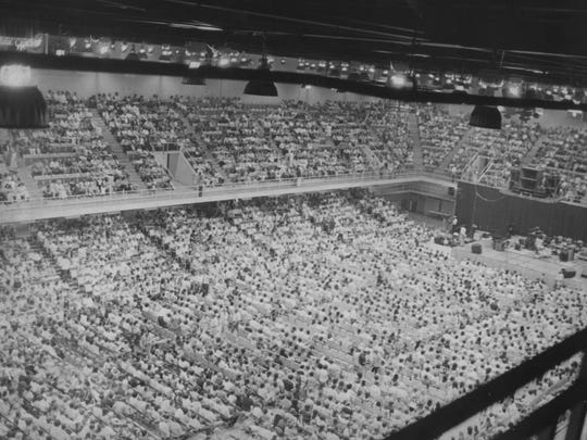 A large crowed packed the U.S. Cellular Center (then called the Civic Center) when Elvis Presley came to town in 1975. An event at The Orange Peel on July 30, Viva Ashevegas!, celebrates the 40th anniversary of the concert.
