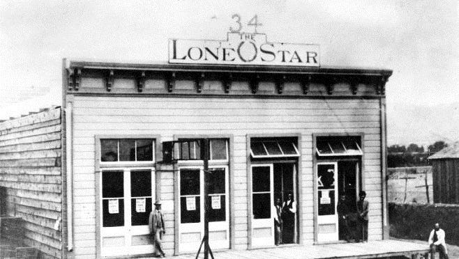 """El Paso, circa 1882: The office of the Lone Star Newspaper, originally the """"Thirty-Four,"""" was moved from Las Cruces to 10 W. Overland St. From left are James B. Gillette, city marshal, two printers (names not listed), Charles M. Shannon, assistant editor, and Simon H. Newman, editor and owner."""