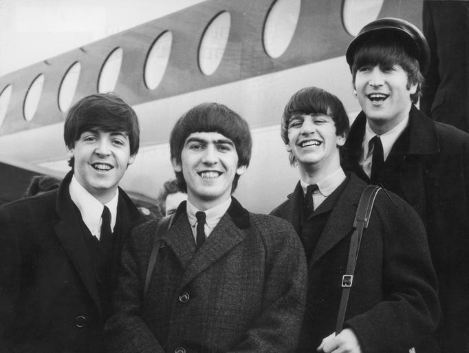 392279 03: FILE PHOTO: The Beatles, left to right, Paul McCartney, George Harrison, Ringo Starr and John Lennon (1940 - 1980) arrive at London Airport February 6, 1964, after a trip to Paris. Conflicting reports were released July 23, 2001 regarding Beatle George Harrison''s battle with cancer. Music producer Sir George Martin was quoted as saying that Harrison expects to die soon from his illnesses. The 58-year-old musician underwent treatment for a brain tumor at a clinic in Switzerland, and had surgery earlier this year for lung cancer. (Photo by Getty Images)