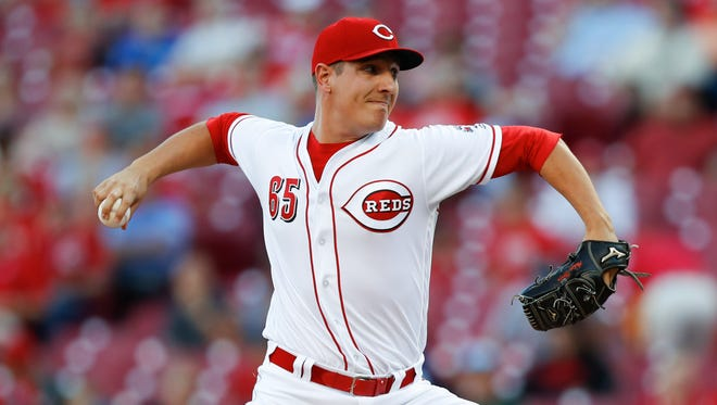 Cincinnati Reds starting pitcher Asher Wojciechowski winds up during the first inning of the team's baseball game against the San Diego Padres on Wednesday, Aug. 9, 2017, in Cincinnati. (AP Photo/John Minchillo)