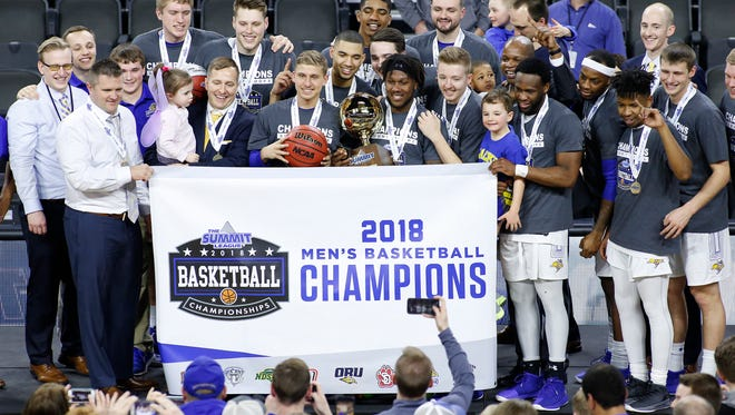 The South Dakota State University Jackrabbits hoist the championship trophy after their 97-87 win over the University of South Dakota at the 2018 Summit League Basketball tournament at the Denny Sanford Premier Center in Sioux Falls.
