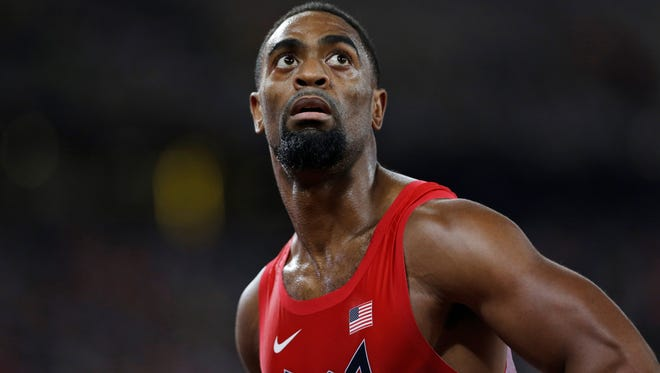 Tyson Gay looks at his time from a men's 100-meter semifinal at the World Athletics Championships at the Bird's Nest stadium in Beijing. The man who used to be considered the biggest threat to Usain Bolt is now often viewed as a bit player in the sprint game. Fine with him, he insists. He's making one last run at the Olympics, doing it for himself and nobody else. (AP Photo/David J. Phillip, File)