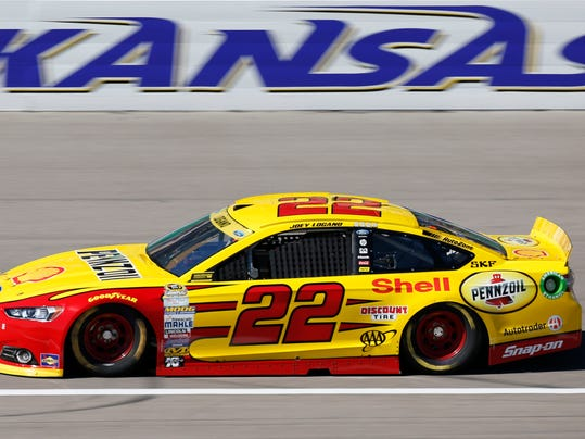 NASCAR Sprint Cup Series auto racing driver Joey Logano takes a practice lap at Kansas Speedway in Kansas City, Kan., Friday, Oct. 16, 2015. (AP Photo/Colin E. Braley)