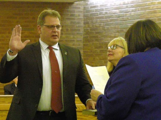 The late Mayor Michael Dachisen pictured Jan. 5 as he was sworn in. Councilman Jeremy Jedynak was also sworn as Councilwoman Patricia Abrahamsen held the Bible.