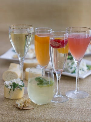 This Jan. 12, 2015 photo shows sparkiling wine cocktails, from left, rhubarb, honey bourbon, crushed, ruby and mojiito in Concord, N.H.