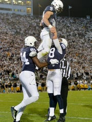 Penn State's Mike Gesicki gives quarterback Trace McSorley a lift after McSorley rushed for a touchdown in the first half of an NCAA Division I college football game Saturday, Nov. 5, 2016, at Beaver Stadium. Penn State hosts Iowa.