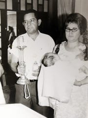 Alfredo Gomez is shown with his wife, Maria Gomez, and child.