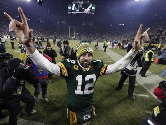 Jan 12, 2020; Green Bay, WI, USA; Green Bay Packers quarterback Aaron Rodgers (12) waves as he walks off the field after defeating the Seattle Seahawks in a NFC Divisional Round playoff football game at Lambeau Field. Mandatory Credit: Jeff Hanisch-USA TODAY Sports