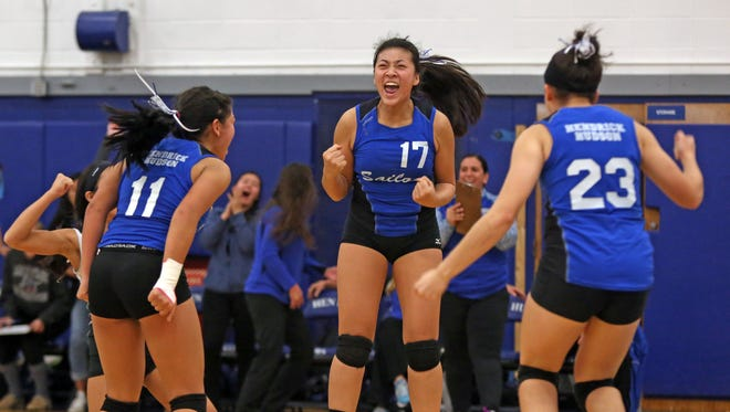 Hendrick Hudson's Kirstin Loh (17) celebrate with her team their win over Yorktown during Section 1 Class A girls volleyball quarterfinal at Hendrick Hudson High School in Montrose Nov. 1, 2016.