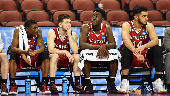 North Carolina State players react on the bench during a loss to Seton Hall in the first round.