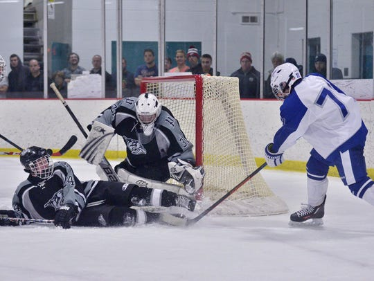 Trying to stymie a scoring chance by Salem's Colin