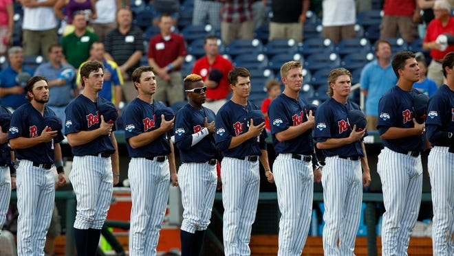 Ole Miss Rebels players observe the National Anthem prior to the game against the TCU Horned Frogs during game ten of the 2014 College World Series at TD Ameritrade Park Omaha. Mandatory Credit: Bruce Thorson-USA TODAY Sports
