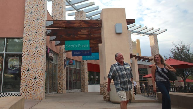 Customers stroll through the outdoor walkway of The River shopping mall in Rancho Mirage. More shade and live entertainment, a Las Vegas-style water feature, a fitness center, chain stores that don't already exist in the Coachella Valley and a shuttle service are a handful of things valley residents would like to see at The River in Rancho Mirage, the city's landmark outdoor mall that new owners are working to rejuvenate.