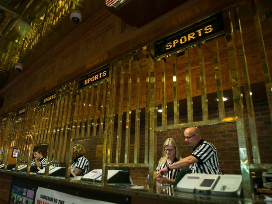 Delaware launched the country's first full-scale sports betting operation outside of Nevada as people roll into the Casino at Delaware Park in Stanton, Del., June 5, 2018.