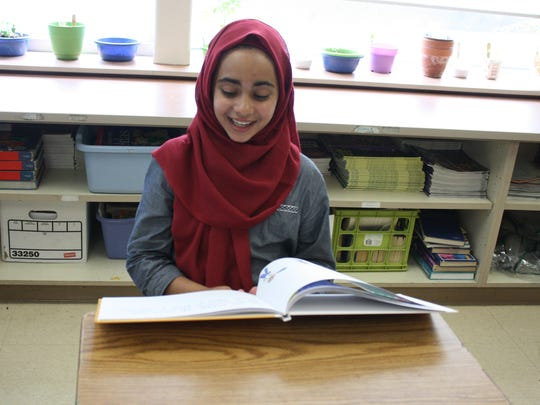 "Tiba Al-Sultani, a fifth grade student at Maine-Endwell's Homer Brink Elementary School, reads from ""My Life."""
