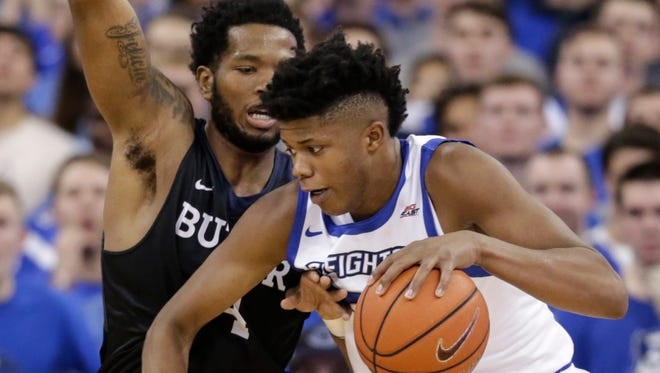 Creighton's Justin Patton, right, is defended by Butler's Tyler Wideman (4) during the first half of an NCAA college basketball game in Omaha, Neb., Wednesday, Jan. 11, 2017. (AP Photo/Nati Harnik)
