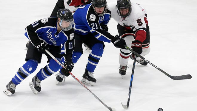 St. Mary's Springs Academy Hockey's Justin Schwartzmiller and Dawson Sarauer battle with Fond du Lac's Logan Graf for the puck during their game Tuesday February 20, 2018 at the Blue Line Family Ice Center. Doug Raflik/USA TODAY NETWORK-Wisconsin