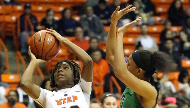 UTEP freshman forward Jakeira Ford, 23, takes a shot against Talequia Hamilton, 0, of Marshall last week at the Don Haskins Center.