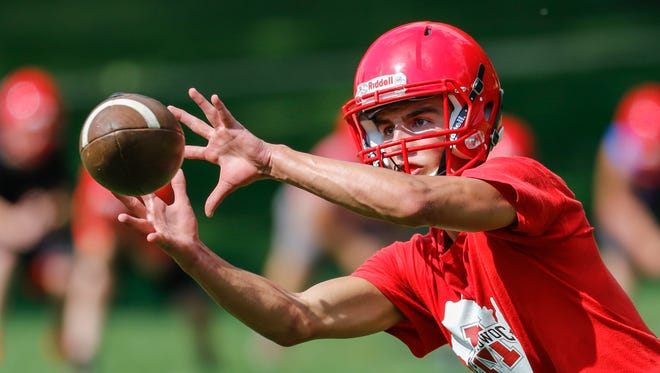 Sophomore outside linebacker Jacob DeBruin catches the ball during an interception drill on the first day of football practice at Lincoln High School Tuesday, Aug. 1, 2017, in Manitowoc, Wis. Josh Clark/USA TODAY NETWORK-Wisconsin
