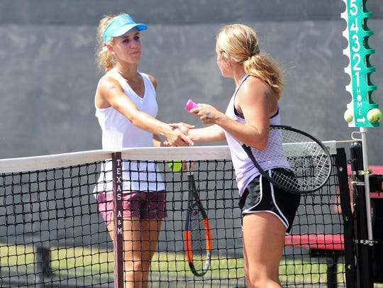 Eula's Anna Masonheimer shakes hands with Comstock's Madison Starkweather following the Class 1A girls singles final.