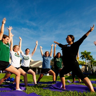 Salima Silverman teaches yoga to St. John Neumann High