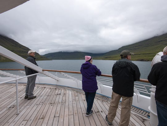 Star Pride passengers gaze out over Seydisfjordur,