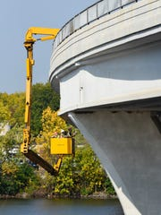 Inspectors from the Minnesota Department of Transportation make their way around and under the University Bridge Thursday, Sept. 14, during a routine annual inspection. The bridge spans the Mississippi River near St. Cloud State University.
