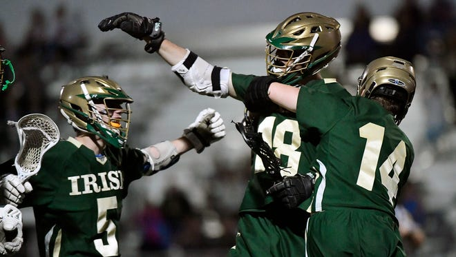 In this file photo from the YAIAA tournament championship game, York Catholic's Cole Witman, second from right, celebrates with his teammates. York Catholic will play in a PIAA semifinal Tuesday.