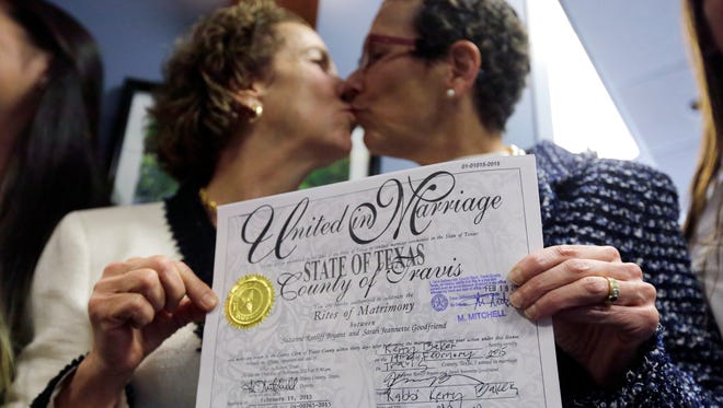 Suzanne Bryant, left, and Sarah Goodfriend marry last month in Austin.