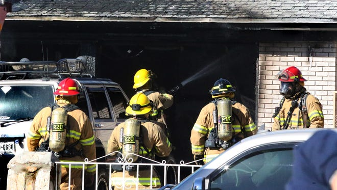 El Paso firefighters extinguish a house fire Tuesday afternoon in the 8500 block of Moye Drive in the Cielo Vista area. The fire broke out in the garage of the home and spread to the roof. There were people inside the home at the time, but they got out safely, a witness said. See video of the blaze at elpasotimes.com.