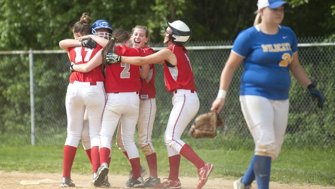 Members of the Haddon Township softball team celebrate after the Hawks beat Maple Shade, 7-6, in Friday's first round game of the South Jersey Group 1 playoffs at Haddon Township High School.