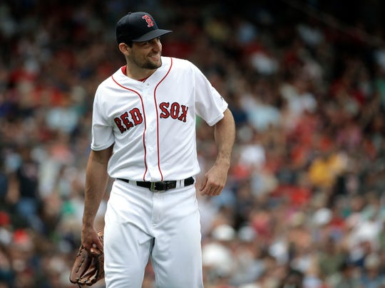 Boston Red Sox's Nathan Eovaldi smiles as he steps off the mound after pitching against the Minnesota Twins in the fourth inning of a baseball game, Sunday, July 29, 2018, in Boston. (AP Photo/Steven Senne)