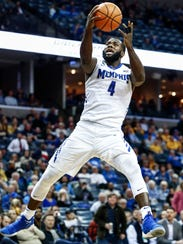 Memphis forward Raynere Thornton (right) drives for