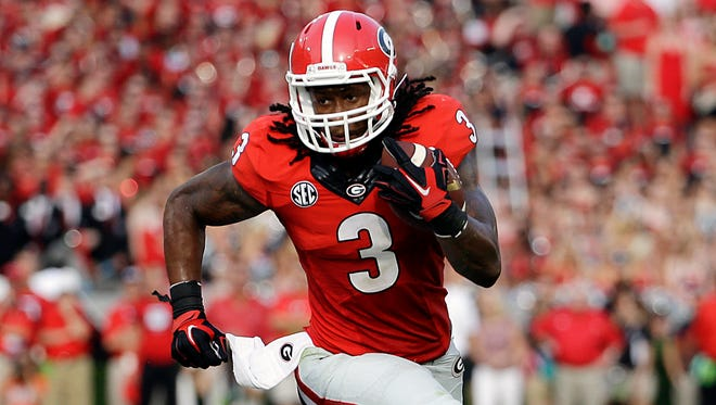 Georgia's Todd Gurley runs the ball in the first half of an NCAA college football game against Clemson, Saturday, Aug. 30, 2014, in Athens, Ga. (AP Photo/David Goldman)