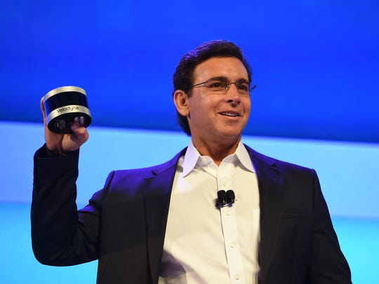 Ford CEO Mark Fields shows off the new Velodyne Puck sensor at a press conference on CES Press Day, January 5, 2016 in Las Vegas, Nevada. The new Velodyne models will be fitted into the side view mirrors of Ford's Fusion Hybrid self-driving cars.
