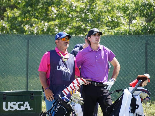 Philip Barbaree Jr. and caddie Roy Lang III compete