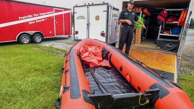 Prattville Fire Department Battalion Chief Ricky Roberts checks on swift water rescue equipment, in Prattville, Ala., on Wednesday August 30, 2017, as the Prattville Police and Fire Departments plan for their deployment to help in hurricane and flood ravaged south Texas.
