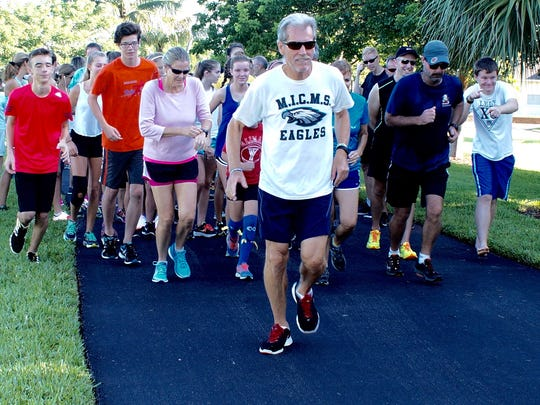 Coach Roger Raymond leads off at the farewell run held