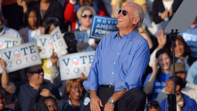 Vice President Joe Biden  wears his Ray-Ban sunglasses on stage at a rally with President Obama on October 10, 2010 in Philadelphia.