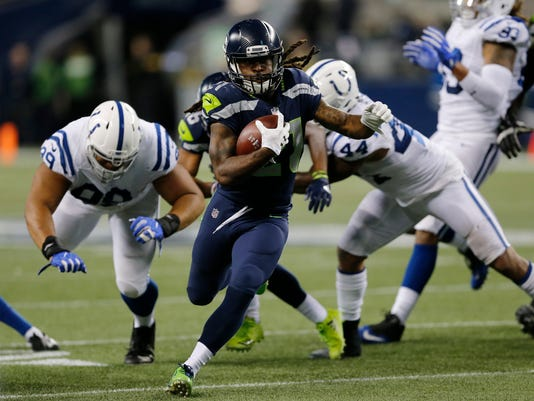 Seattle Seahawks running back J.D. McKissic runs for a touchdown against the Indianapolis Colts in the second half of an NFL football game, Sunday, Oct. 1, 2017, in Seattle. (AP Photo/Stephen Brashear)