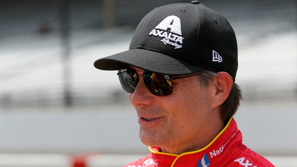 Jeff Gordon stands on the grid during qualifying for