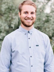 Dustin Gale, a senior at Southern Utah University, helped design a house for a woman at Canyon Creek Women's Crisis Center.