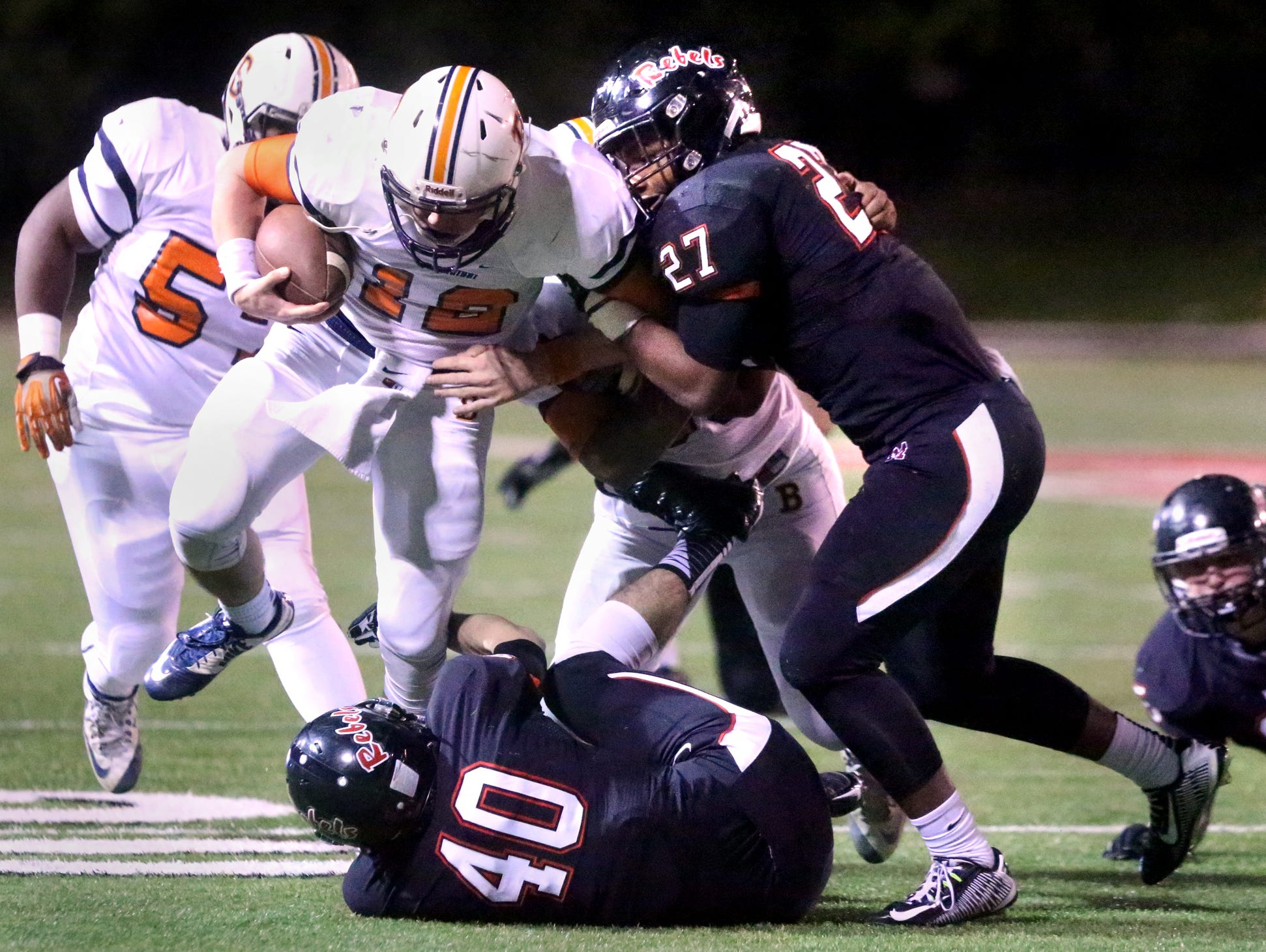 Maryville's T.D. Blackmon moves in to stop Blackman's quarterback Miller Armstrong (12) as Arstrong runs the ball during the quarterfinal game, at Maryville, on Friday, Nov. 20, 2015.