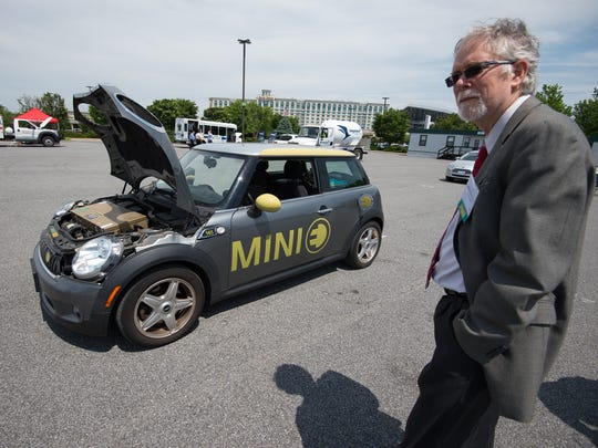 Willett Kempton of Newark stands next to his electric Mini Cooper at the alternative fuels workshop at Dover Downs Casino in Dover.