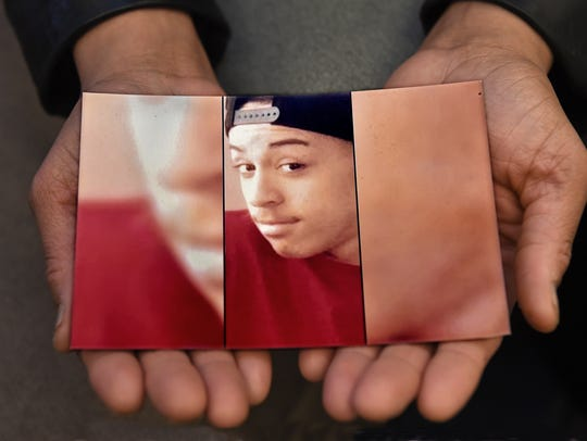 Shanee Ball's holds a picture of her son Terry Ball,