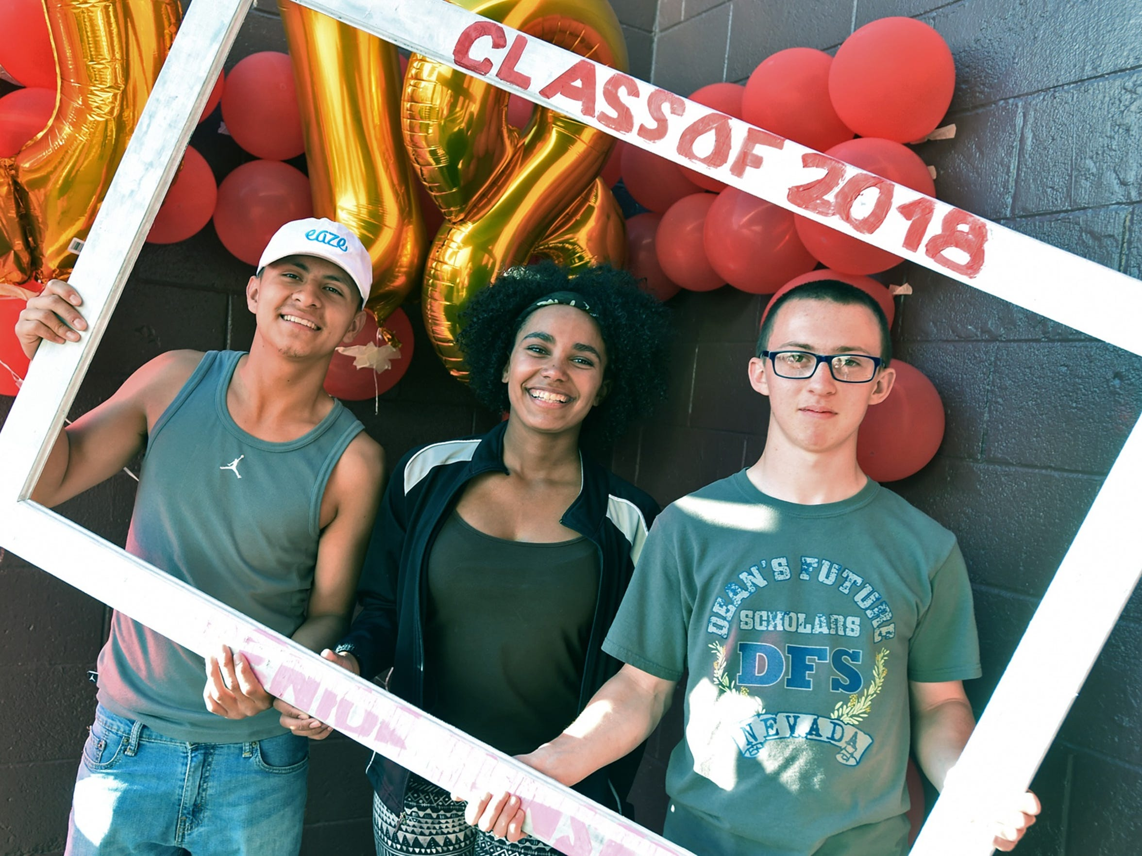 Sparks Middle School shooting survivors Justin Fuentes, left, Elizabeth Long, center, and Neil Penrod pose for a photo during Senior Sunset at Spark High School. All three will graduate from Sparks High.