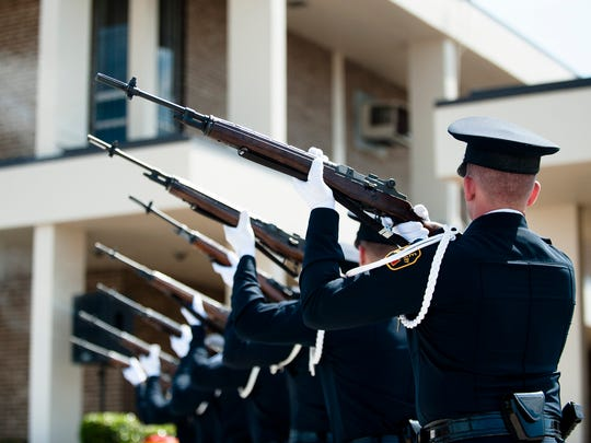 Montgomery Police honor guard fire off a 21 gun salute during a the Montgomery Police 2017 Memorial Day Service on Wednesday, May 17, in Montgomery, Ala., The service was held in memory of the 28 fallen officers who have died in service of Montgomery.