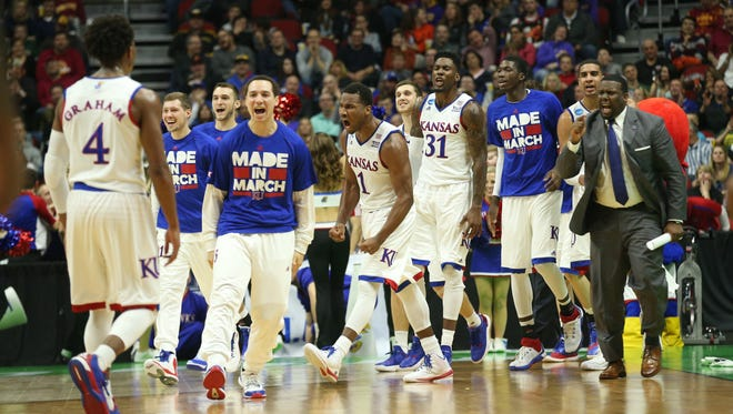 The Kansas bench celebrates during a timeout against UConn during the first half Sat. March 19, 2016, of their NCAA Div. I men's basketball championship second round game at Wells Fargo Arena, in Des Moines, Iowa.