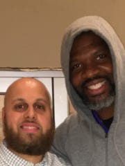 New Coach - Tristian Gregory (left) stopped to get a picture with newly named University of Evansville Men's Head Basketball Coach, Walter McCarty, while attending a birthday party for Ben Shoulders at Party Central. Coach McCarty is making his rounds since being back in his hometown of Evansville.